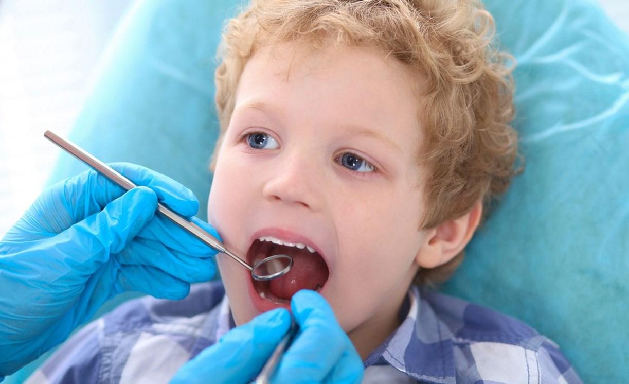 Удаление зуба молочного